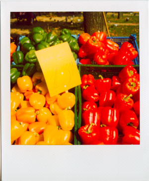 Green, red, and yellow peppers at a farmers' market in Frankfurt, Germany
